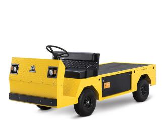 A yellow and black Cushman construction cart is parked in front of a white backdrop.