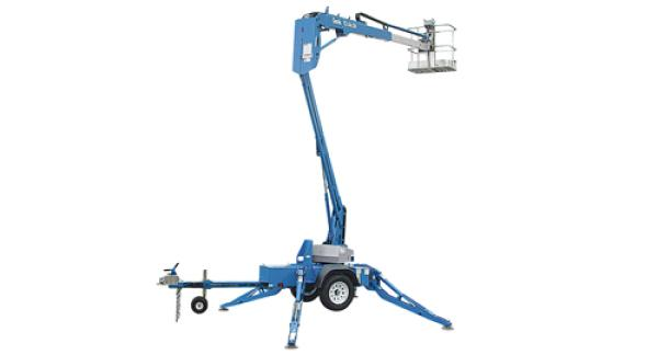 A large blue crane lift is stationed fully-extended in front of a white backdrop.