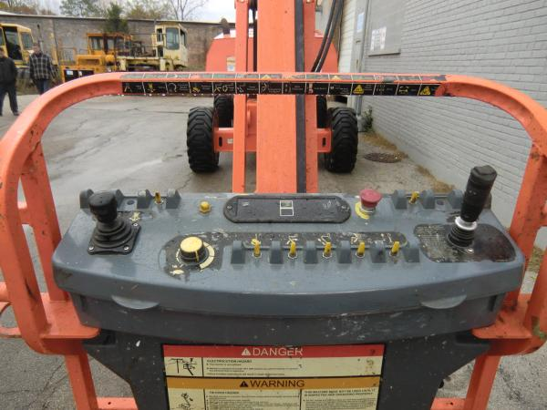 An operating board with various levers, buttons, gauges, flips, and switches for a piece of heavy machinery.