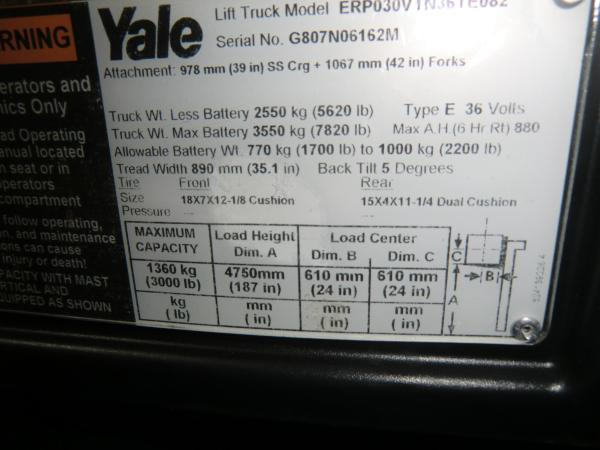 A close-up shot of a tag that is located on a piece of Yale heavy machinery that contains information about the machine.
