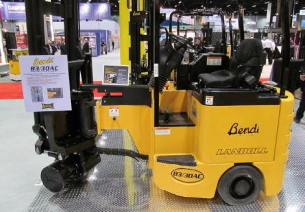 A black and yellow piece of heavy Bendi machinery is located in a showroom for sale.