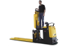 A man standing on a piece of black and yellow Yale material handling equipment in front of a white backdrop.